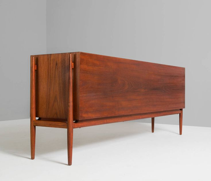Rare Sideboard by Finn Juhl in Teak for Niels Vodder | From a unique collection of antique and modern sideboards at https://www.1stdibs.com/furniture/storage-case-pieces/sideboards/