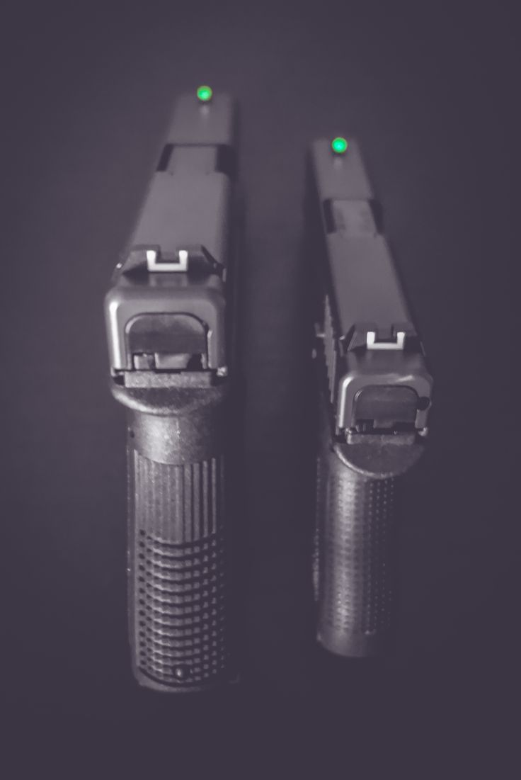 Glock 19 & Glock 42 mounted with night sights.