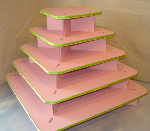 """Cupcake tree.  Because I'm cheap and don't want to pay $27 + shipping for cardboard, I'm thinking I can use cake squares or rounds and plain cardboard in an """"x"""" formation as the spacers.  Cover each square in fabric or paper & use ribbon on the edge."""