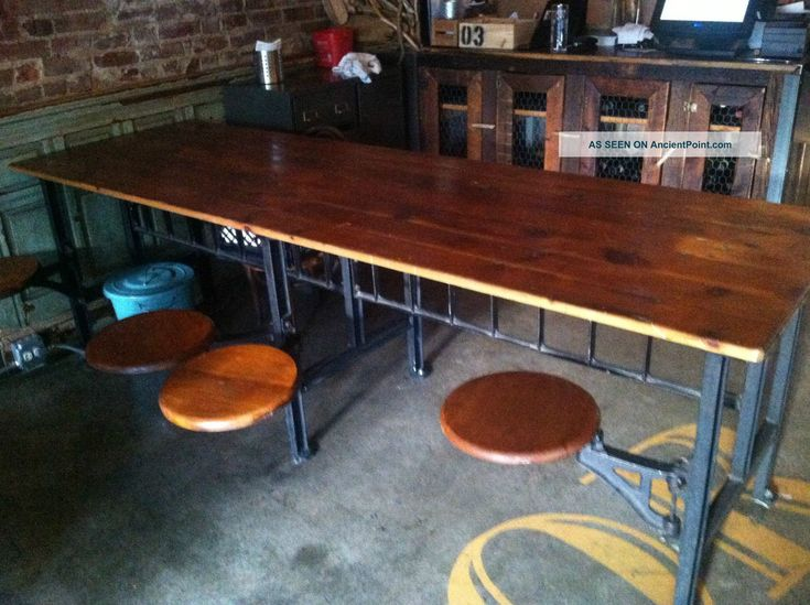 Industrial Table With 8 Swinging Stool Attached Post 1950