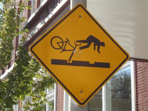 Google Image Result for http://www.vivaboo.com/wp-content/uploads/2011/08/riding-bikes-without-front-tires-can-be-dangerous-funny-yellow-diamond-sign-caution-travel-humour-humor-street-sidewalk-pothole-beware-be-warned.jpg