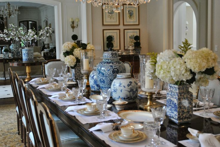 blue and white ginger jars with hydrangea blooms in dining room.