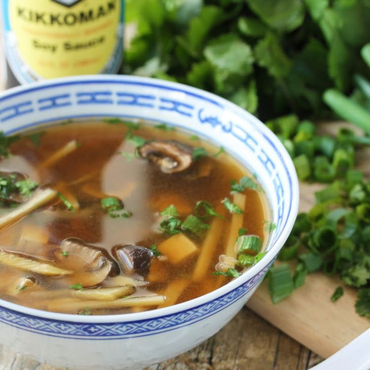 Slow Cooker Chinese Hot and Sour Soup Recipe Soups with chicken broth, Kikkoman Soy Sauce, rice vinegar, bamboo shoots, mushrooms, fresh ginger, Sriracha, white pepper, sugar, firm tofu, chopped cilantro, sliced green onions