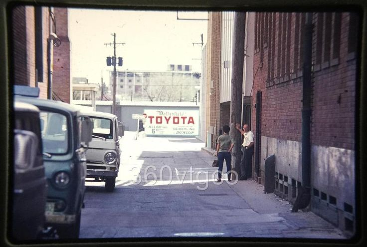 1971 photo slide of an ally with a Toyota sign painted on the wall  | eBay
