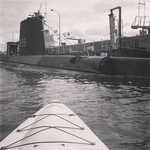 Kayaking my Fluid Bamba in the Simons town Naval base. Old submarine!