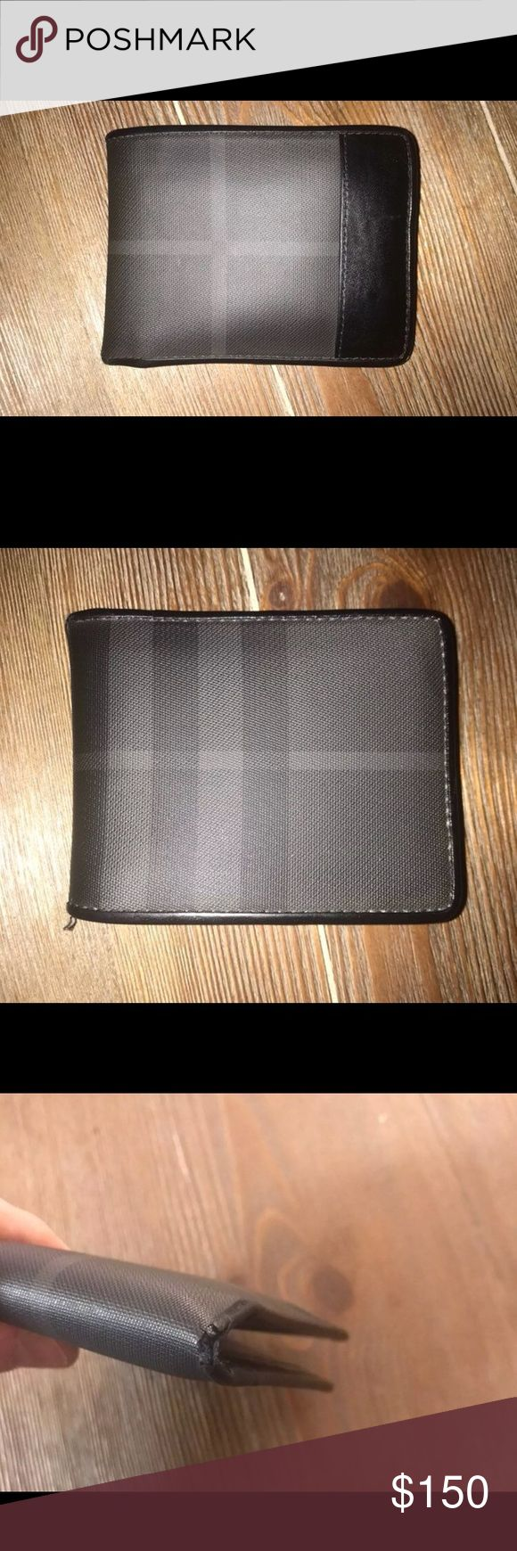 Burberry bifold wallet Used men's Burberry wallet. Wear on corner shown in photo but still in great shape. All offers  considered. Thanks for looking! Burberry Bags Wallets