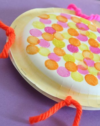 Looking for a noisemaker that's more musical than your kid's typical banging and clanging? Make a paper plate tambourine!