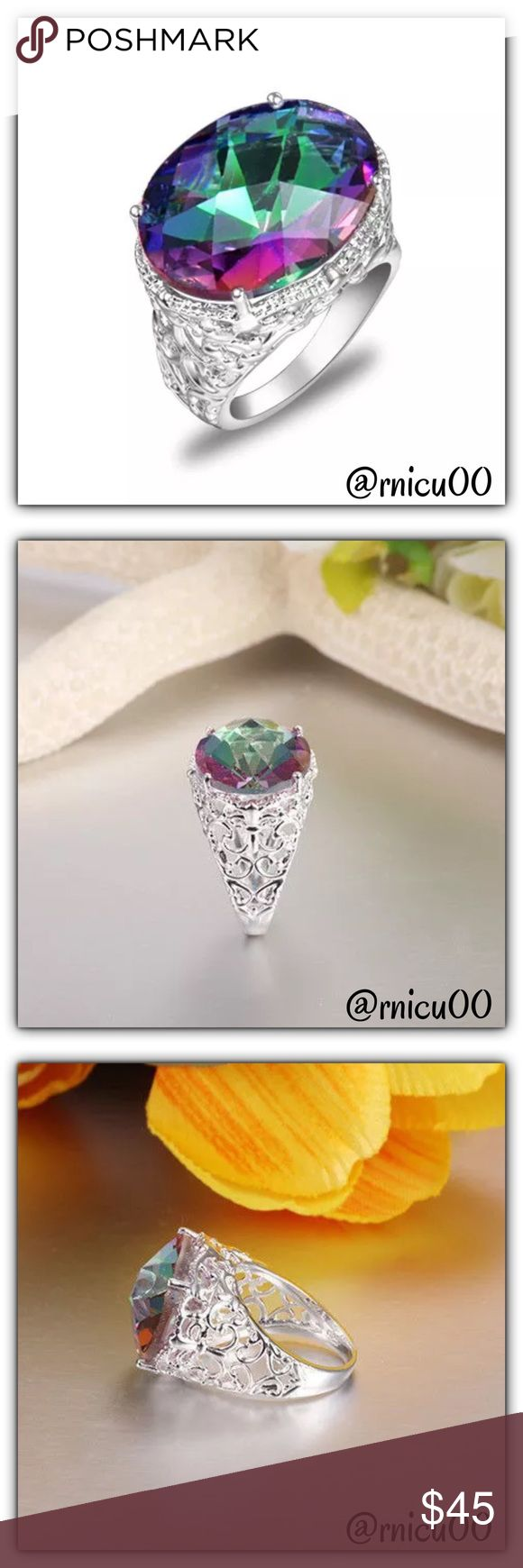 """🆕46ct Rainbow Mystic Topaz 925 Sterling Ring! Stunning is the first word that comes to mind here!! Rainbow Mystic Topaz is such a Beautiful Gemstone; this is set on a Intricately detailed Sterling Silver Band. Definitely a show stopper!  - Metal: Stamped """"925"""" Sterling Silver  - Gem: Rainbow Mystic Topaz - Stone size: 23X18mm (0.9""""X0.7"""") - Weight: 46tcw - Will Ship Securely in Jewelry box👌  *NO TRADES *Prices are FIRM-Listed at Lowest Price Unless BUNDLED! *Sales are Final-Please Read…"""