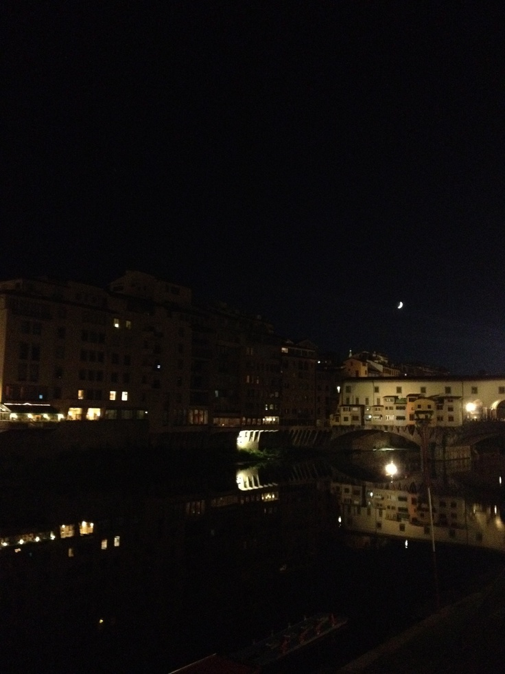 Night time reflections on the river Arno