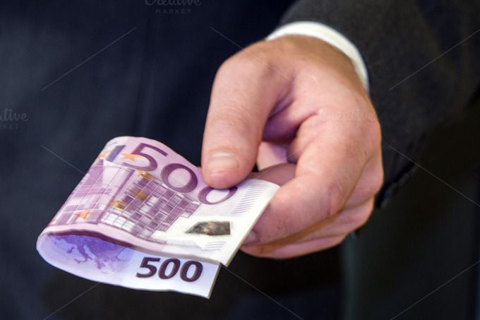 Hand giving money by Aljndr  on Creative Market