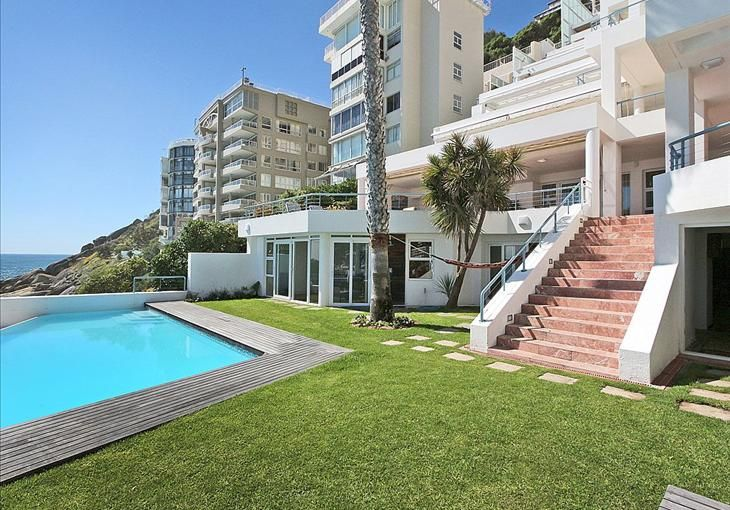 Unsurpassed position, direct access to Moses Beach, entertainment space for over 200 guests, heated seawall pool, four ocean facing bedrooms, four bathrooms, additional guest cloak rooms, large reception areas, extensive covered terraces, exquisite private garden, playroom/gym, Jacuzzi. - See more at: http://search.knightfrank.co.za/za3151101#sthash.T05HZiAU.dpuf