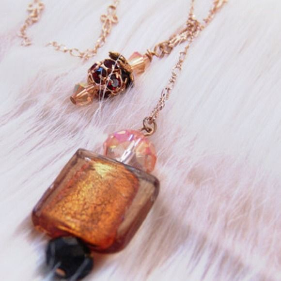 """The De Medici Pendant Necklace Hanging from an 18"""" total length chain (measured flat) are two hand-crafted charms. The larger centerpiece charm is hand-made using a vibrant Chinese lamp work rectangle, which is surrounded by Chinese crystal and measures 1.5"""" in length. The smaller charm is a brilliant crimson-red Swarvosky crystal encrusted orb, surrounded by Czech crystals.  This necklace hangs approximately 7"""" from the base of the neck/collarbone when on. Gilded Eccentric Jewelry Necklaces"""