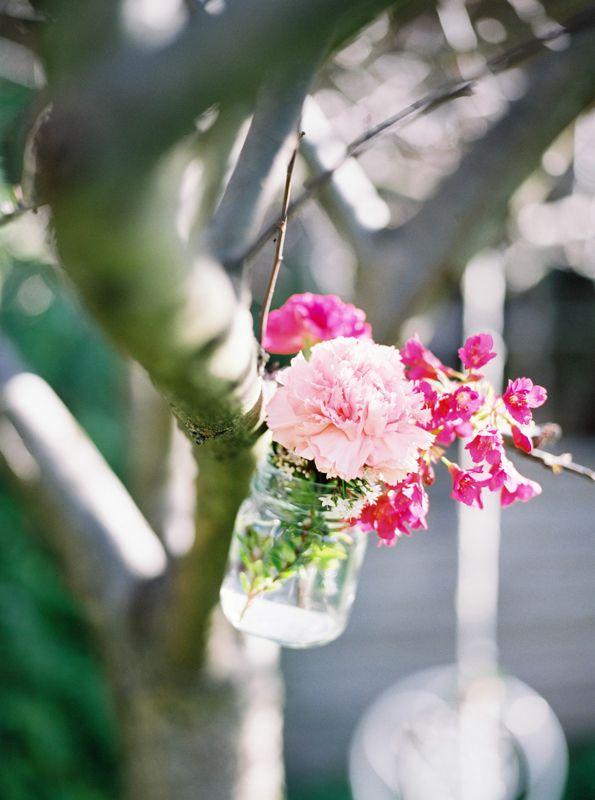 edjones.photo these jars were a great way to add some colour to a winter tree! #vintagewedding #tasmanianwedding