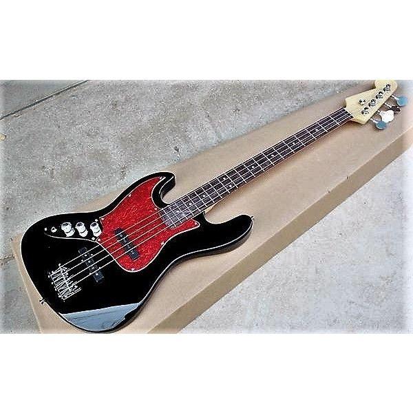 Fender Jazz tribute. 4 string with black body. Left handed model.