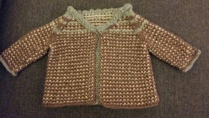 A soft and warm knitted jacket for infants.