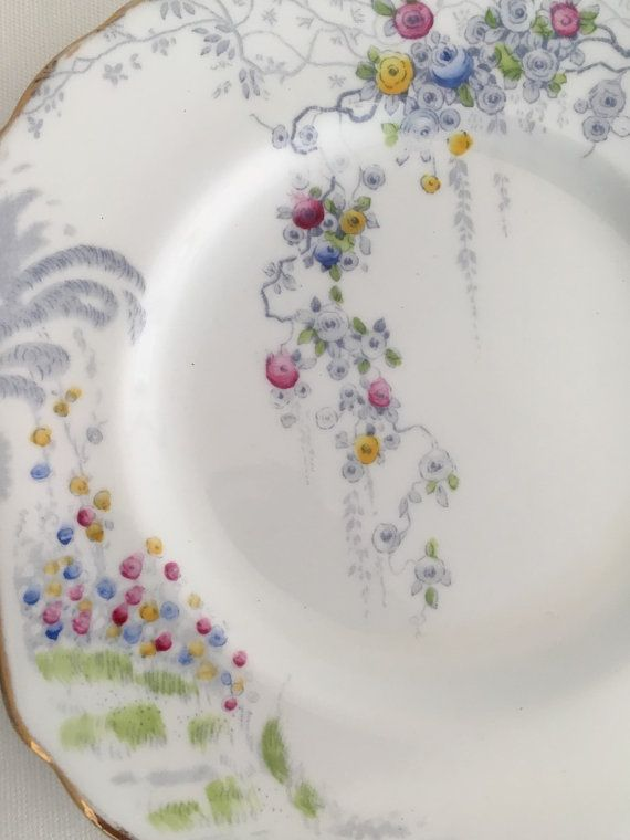 Sutherland bone china side plate pattern numbered 1380E from Hudson & Middleton Ltd manufacturers at the Sutherland Works, Longton, England until 1941. The listing is for one side plate. Matching pattern pieces may be available Please convo for details Colourful though subtle patterns of bouquets of trailing multicoloured flowers and foliage plus a landscape scene complete with outlined pathway and floral archways create a romantic theme. All set against a white ground and gold trim. Gilt...