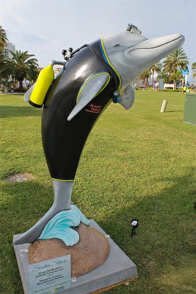 Sponsor:  Sunset Vistas Beachfront Suites  Artist:  Jesse Wilhelm's Artistic Vision Inc.  Photo credit:  Jay Richmond Photography  One of 50 themed dolphins on display at Pier 60 Park, Clearwater Beach, until 9/4/12.  #ClearwatersDolphins
