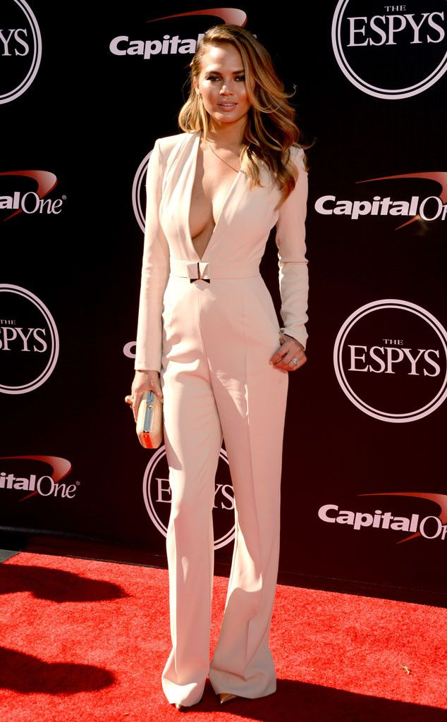 Chrissy Teigen flaunts her beautiful bod in a peachy-nude jumpsuit.