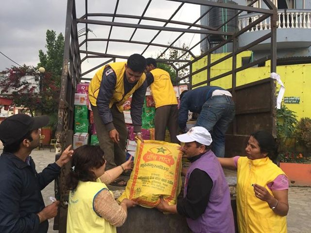 Packing and transporting food to earthquake victims.