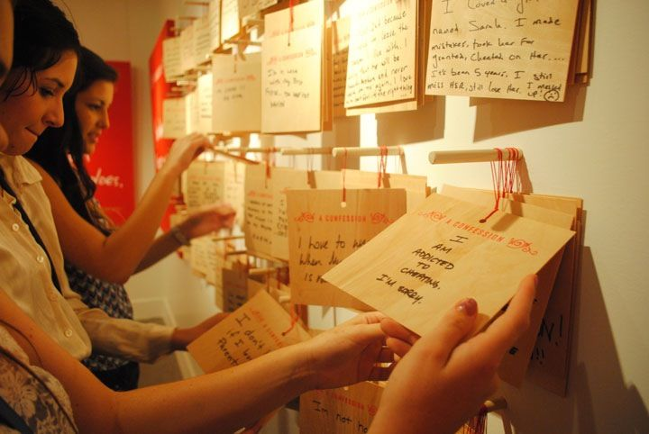 las vegas: anonymous confessions   another interactive installment by candy chang. people wrote and submitted confessions on wooden plaques in the privacy of a confession booth... then they were displayed for all to see.