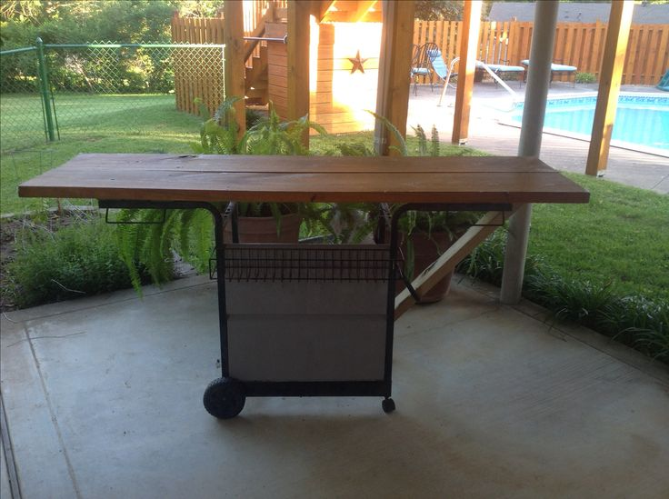 Recycle your old gas grill by turning it into a portable work bench.  (Made by my dad!)