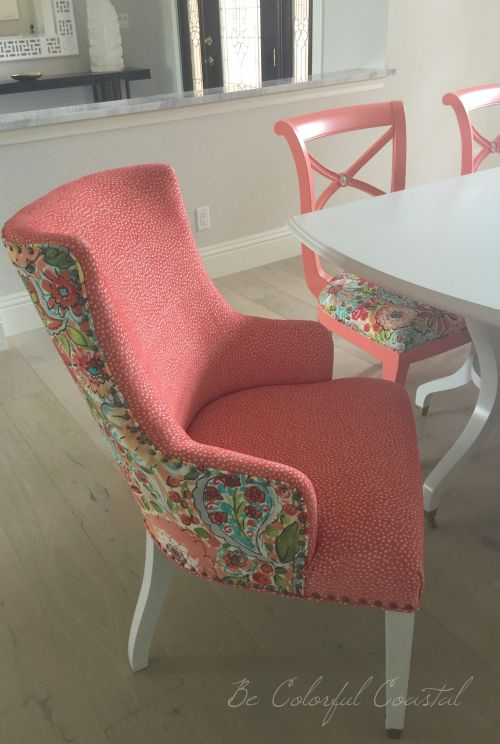 Colorful dining room. Mixed colorful coral fabrics on a traditional host chair. Coral dining chairs.