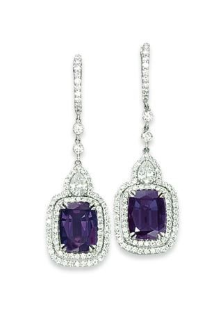ALEXANDRITE AND DIAMOND EARRINGS.  Alenaxdrite is a tri-color stone that is very valuable and coveted.  Depending on the light you are in the stone may appear green, blue or purple. What a great stone to own - of course some stones are better than others, buy from a gemologist who knows what they are doing.