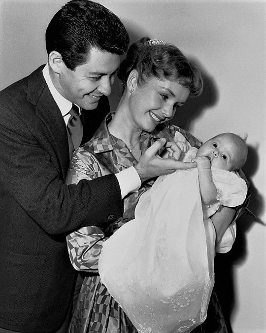 P for parents: Debbie Reynolds & Eddie Fisher with their baby girl, Carrie Fisher.