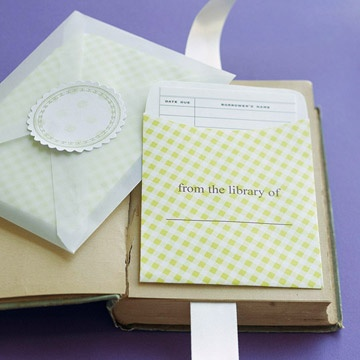 """Book Club    Avid readers will love this handy system for personalizing and keeping tabs on their prized books. Purchase printable envelopes and book check-out cards at a school supply story. Print """"from the library of"""" on each envelope. Insert the cards into envelopes and then package several of them into a larger vellum envelope; seal with a sticker."""