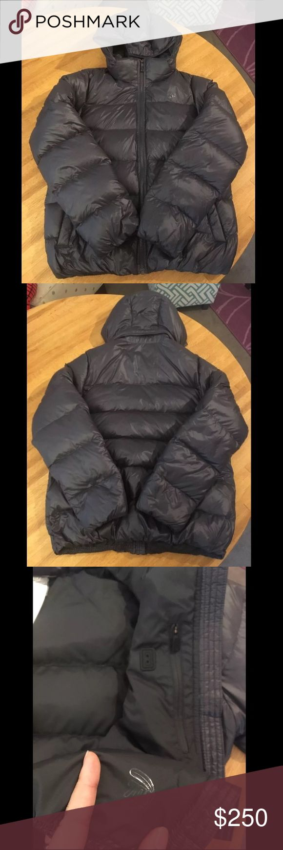 Rare* Nike down jacket Size- Woman's large, could also possible be a men's small to small medium Condition- NWOT (never worn, but tags were removed) Color- Dark grey/black   100% authentic   Released in 2012   VERY hard to find   Removable hood  Pocket inside jacket for a phone and headphones  Zipper pockets in front  700 grade down  Super light and breathable   Perfect putter layer or under layer  FIRM price due to having marked it down over $125! ❤️  Thanks for looking nice Nike Jackets…