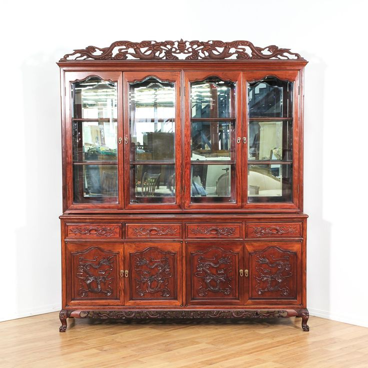This asian china cabinet is featured in a solid wood with a gorgeous glossy rose wood finish and intricate carved floral and dragon details. This large buffet hutch has a top display case with shelving and a mirror back, 4 drawers and base cabinet storage. Stunning and ornate piece perfect for displaying fine china! #asian #storage #chinacabinet #sandiegovintage #vintagefurniture