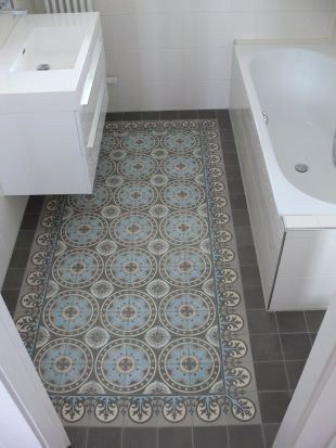 I love how this tile inlay looks like a throw rug but won't become gross!