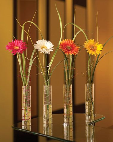 different height skinny vases with individual flowers - just not all gerberas, and just white and yellow, NO PINK