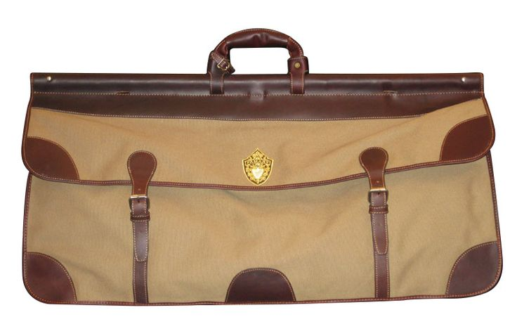 This firearm case is great for travel with your rifle or shotgun.  •It measures 83x34x40cm.   •Made of 100% cotton with leather finishing.  •Available in Brown with Dark Brown accents and a Blue, Green, and Red Plaid interior.