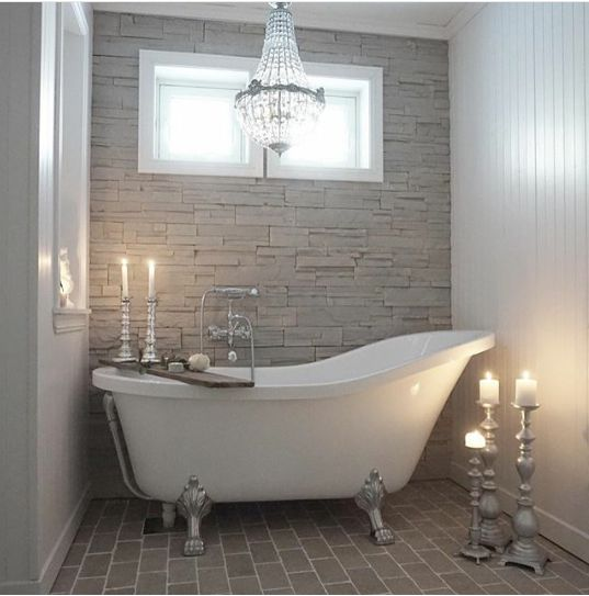 Classic Bath Tub Area With Stone Mosaic Feature Wall And Brick Tiles Floor