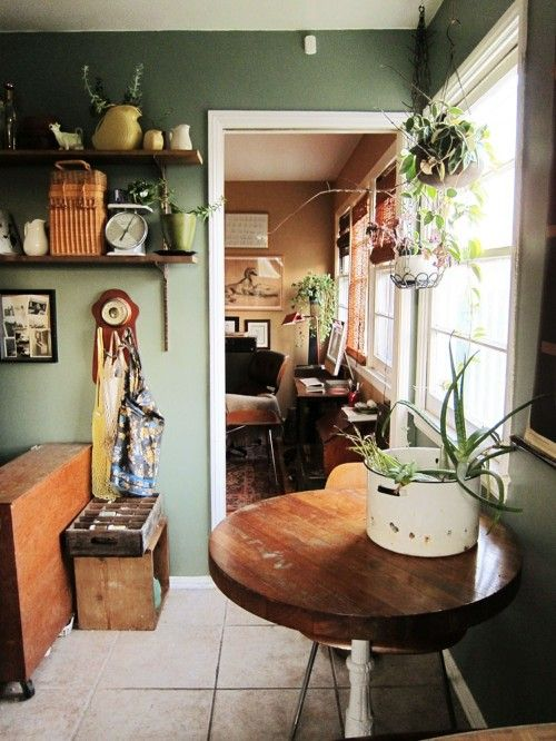 if you look closely... you'll see the cow on the shelf there to the left... i have one similar with a poppy and some blue bonnets painted daintly on it.