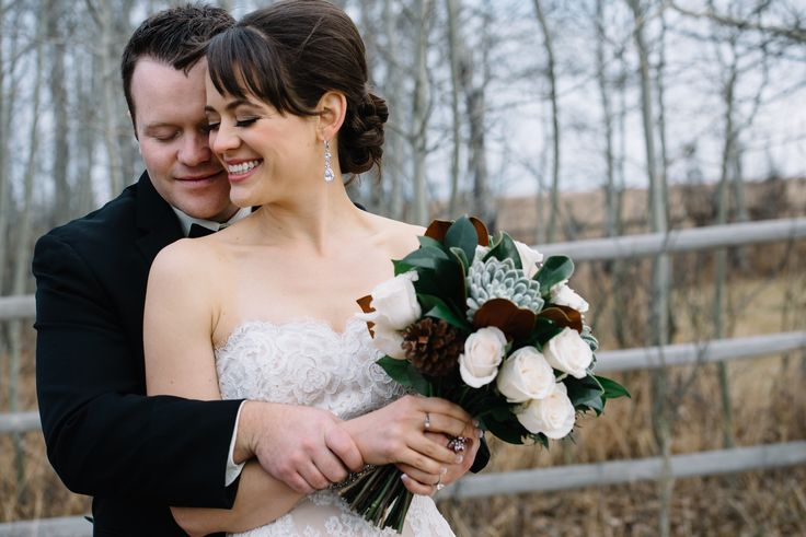 November wedding and love is in the air! Our beautiful bride held a bouquet of Vendela roses, succulents, pine cones and magnolia leaves.  Flowers by Janie- Calgary Wedding Florist www.flowersbyjanie.com  Photo: http://abbyplusdave.com