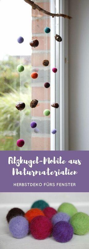 Herbstdeko fürs Fenster: Filzkugel-Mobile mit Naturmaterialien