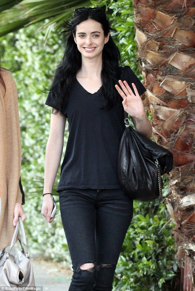 Natural beauty: Krysten Ritter smiled and waved as she went out for a make-up free stroll ...