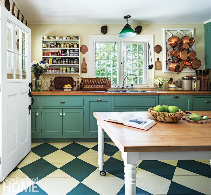 1920s Cottage Kitchen New flooring and cabinetry give the kitchen a fresh look.