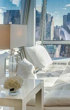 Diamond-angled windows enhance the Times Square views from Midtown Jewel 34E, New York