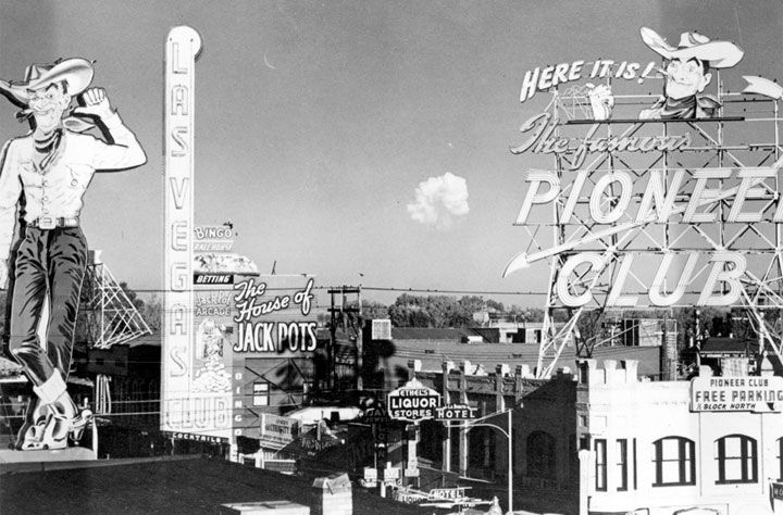 "Atomic cloud at Nevada Test Site, seen from downtown Las Vegas, 1951. The Nevada Test Site, 65 miles northwest of Las Vegas was created in 1950. The first nuclear experiment - see here from 1st street - was held on Jan. 27, 1951. Las Vegas embraced the nuclear age, hosting a ""Miss Atomic Bomb"" patent and bomb-watch parties. Nuclear testing continued until September 1992 when a moratorium went into effect."