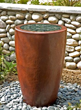 """Here's how to build a one-of-a-kind water feature in a weekend.    This water feature consists of an underground, waterproof basin; sturdy grating; and a pot of your choice. Most of the supplies you will need can be found at a plumbing supply or hardware store or a nursery that carries water garden supplies.    Step 1: Plumb the pot  For this step, you'll need your decorative pot, a 1 3/4"""" by 1"""" barb fitting, a 1 3/4"""" PVC female a"""