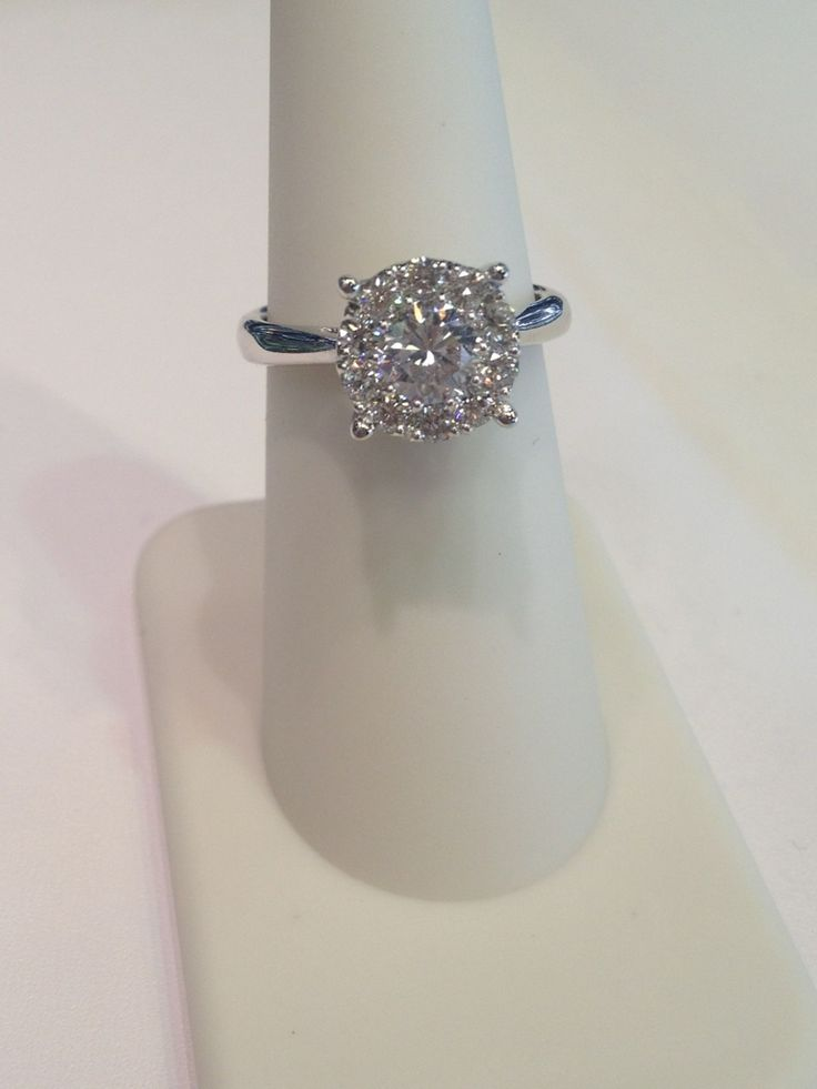 Simple but elegant. With this cluster engagement ring.