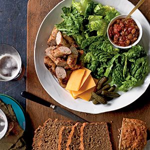 Ploughman's Lunch. A traditional pub salad made with sausages, cheese, and any combination of mixed lettuce, tomatoes, cucumbers, coleslaw, or chutney. Serve with soda bread.