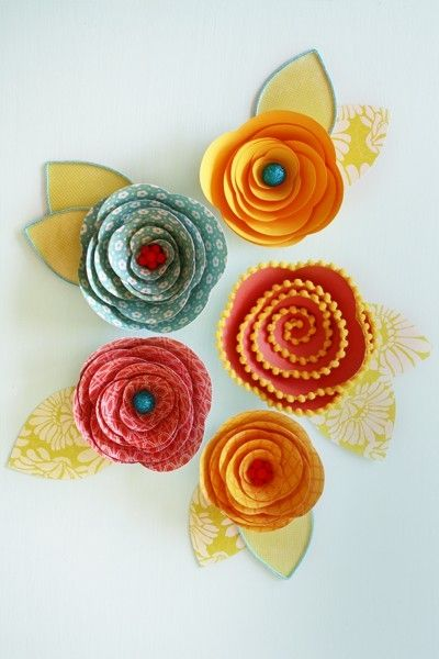 DIY Rolled Paper Flowers can cut out with cricut. Like the ideas for centers.