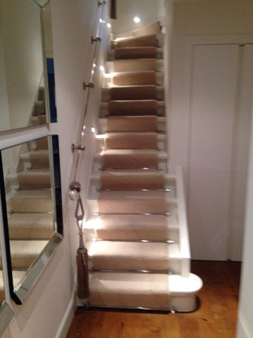 Client: Private Residence In West London Brief: To supply & install carpet to stairs as a runner with stairrods