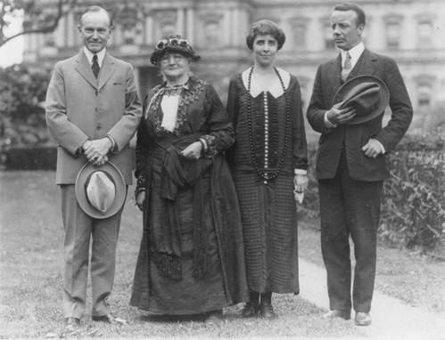 1924. Mother Jones stands in front of the White House with President Calvin Coolidge, First Lady Grace Coolidge and Theodore Roosevelt Jr. Look at these sharp suits and Grace's amazing necklace. Mother Jones is looking distinctly from a different decade whereas the others are typically early 20s.