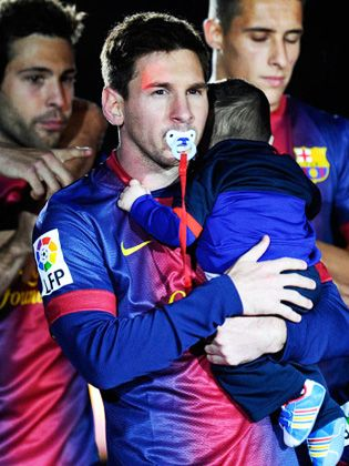 Barcelona superstar Lionel Messi and his baby son