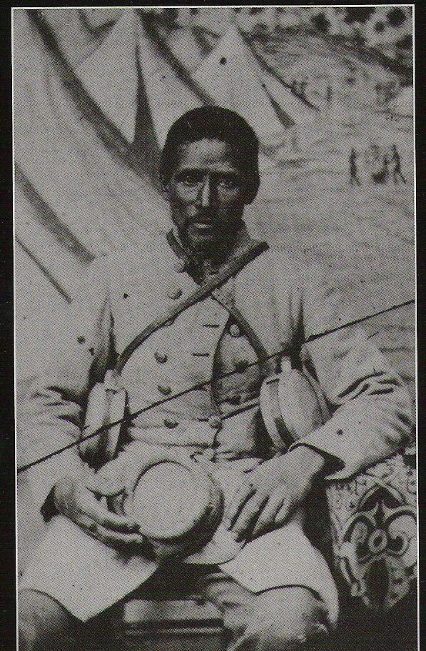Black confederate soldier sitting for portrait. American Civil War